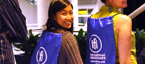 Student wearing IFI welcome bag